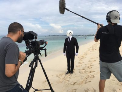 Actor humanoid Robot costume walking beach