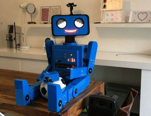 Hugo, the talking robot, sitting on a table
